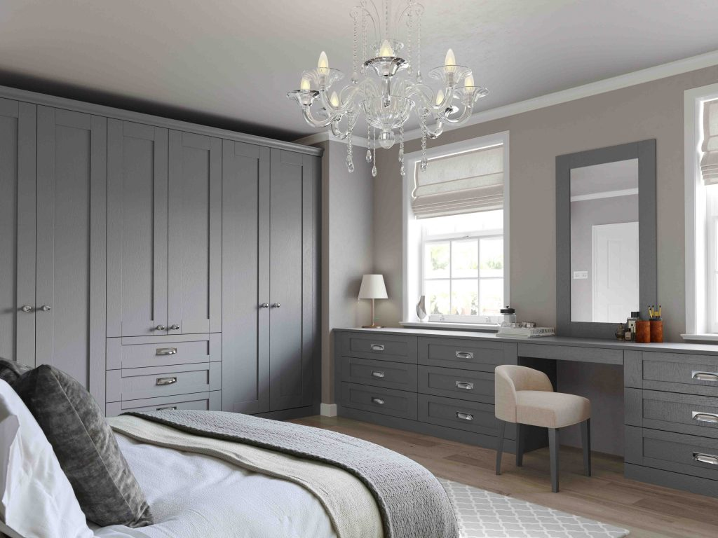 Finsbury wood grain effect dust grey with modern cup handle and knob to complete this elegant and modern bedroom.