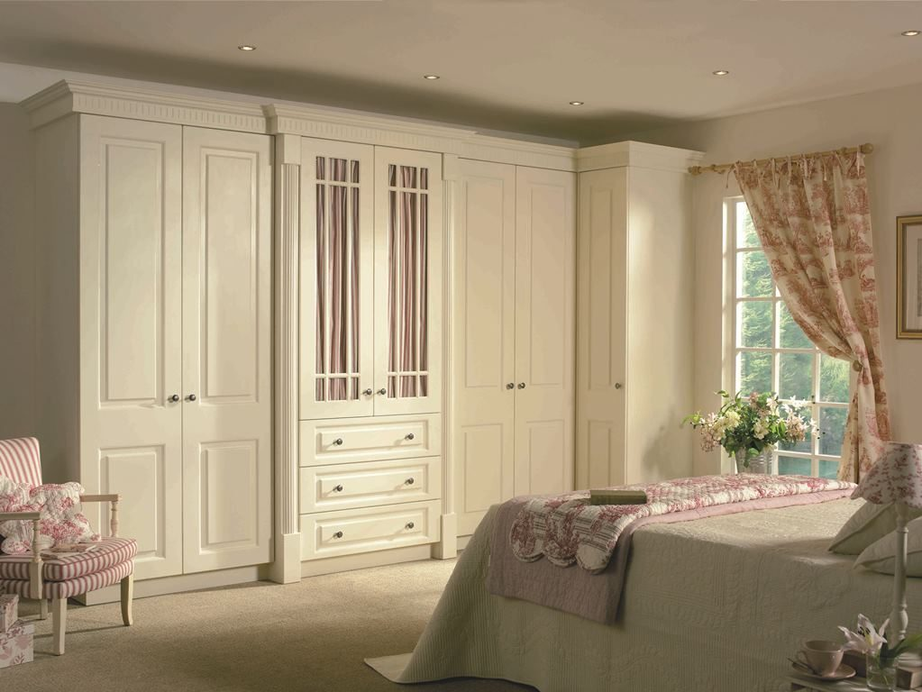 Prague ivory in ivory with fluted rail cornice, reeded  pilasters and fretted frames combine to create a sophisticated and elegant bedroom.